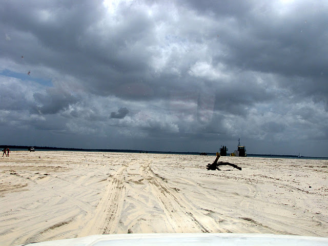 Driving across Rainbow Beach on our way to the Fraser Island barge