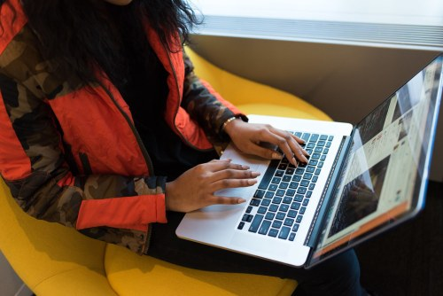african american female with her fingers typing on a computer keyboard
