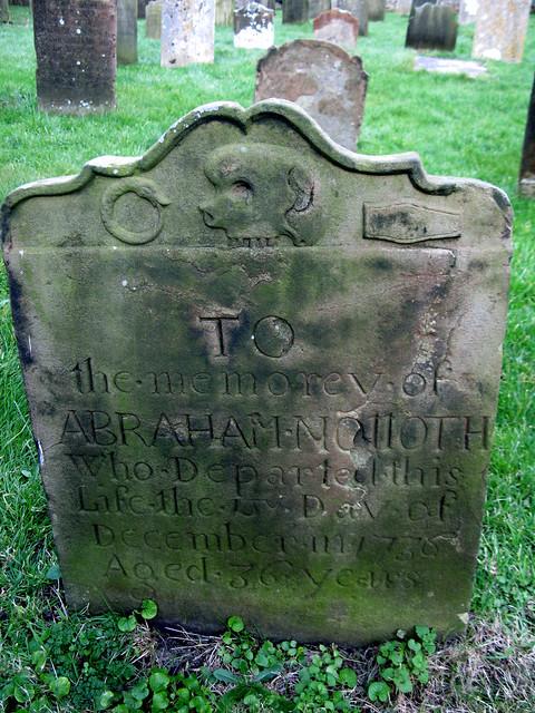 gravestone with oroborous