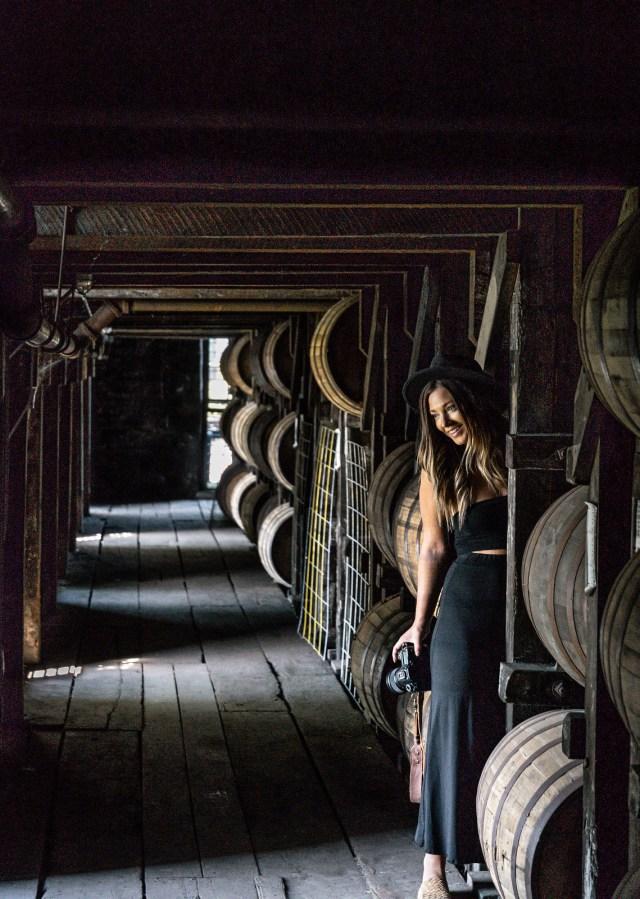 Hayley exploring among the barrels