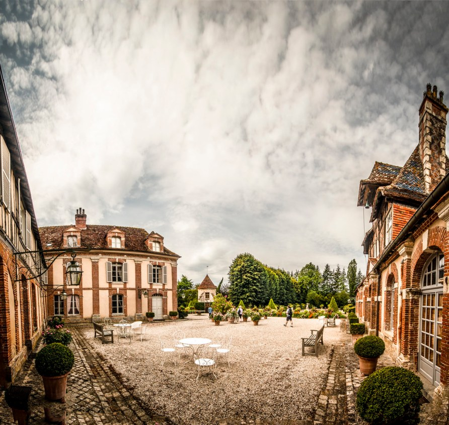 looking across the charming courtyard of Château de Boutemont under a summers day sky, Ouilly-le-Vicomte, Calvados, Normandy, France