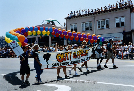San Diego LGBTQ Pride Parade, July 1995: Volunteers holding 'Out & Free' 1995 theme Banner