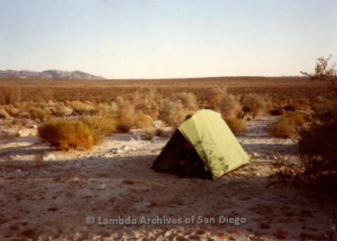 P008.065m.r.t Anza-Borrego Desert 1984: A hiker dressing inside a tent