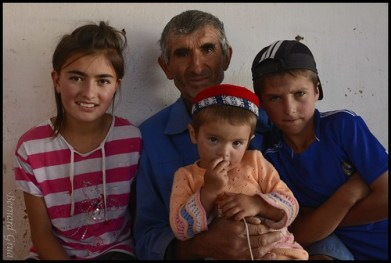 Tusion, Tajik Pamir, The wise Abdurahim with kids who adore their grand father, a retired « tractorist ». The baby has a Pamiri hat. © Bernard Grua