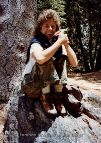 P008.027m.r.t Mt. Palomar 1983: Mary Russell sitting on a rock at Asher's cabin
