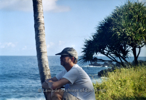 P338.010m.r.t Charles McKain sitting on beach in Maui