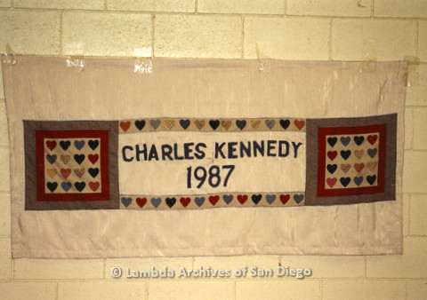 P019.032m.r.t AIDS Quilt at San Diego Golden Hall 1988: Heart decorated beige quilt dedicated to Charles Kennedy