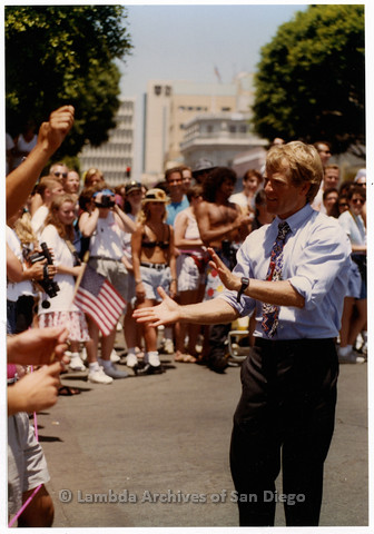 P201.014m.r.t San Diego Pride Parade 1992: Mayoral candidate Peter Navarro walking down street and interacting with crowd