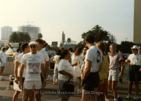 """P197.012m.r.t San Diego Walks For Life 1988: Crowd of runners in parking lot including a man wearing a shirt that reads: """"The Little Guy"""""""