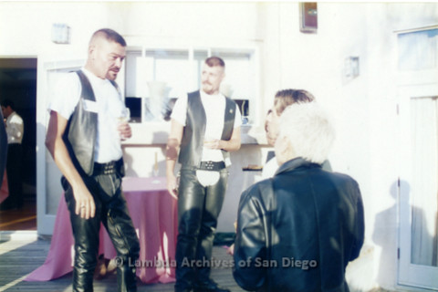 P022.062m.r.t The Center, Centre Street, Donor Appreciation Party: Two men in leather chaps with others