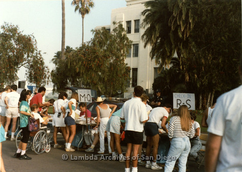 """P197.006m.r.t San Diego Walks For Life 1988: Walkers checking in at tables with signs that read: """"Check in M-Q"""" and """"Check in R-S"""""""