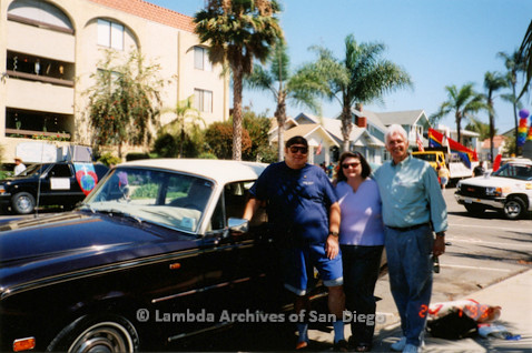 P018.162m.r.t San Diego Pride Festival 1999: Two men and a woman standing beside car before parade