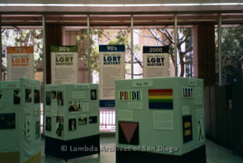 P119.054m.r.t LASD City Hall Exhibit 2010: Hanging banners detailing timeline of San Diego LGBT History from pre-1970's through the 1990's