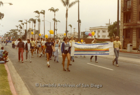 1982 - San Diego Lambda Pride Parade, 'Front Runners' Contingent a LGBT running/walking group carry their banner marching up 6th avenue toward Hillcrest.