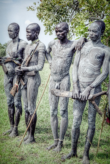Surma men with weapons