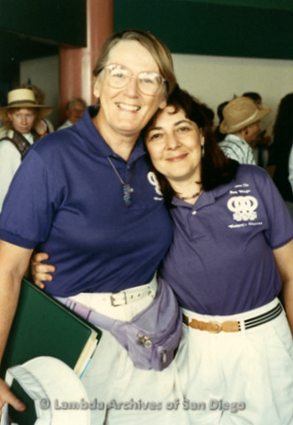 """""""The Magic Music Makes"""" San Diego Women's Chorus (SDWC) first choral festival with Sister Singers 1991: Lesbian Couple Sheila Clark and Judy Reif hug at San Diego Airport after returning home from the Music Festival."""