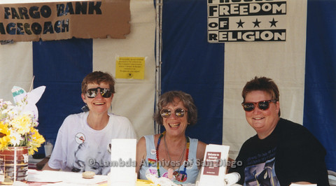 Sharon Parker(left) and  Gloria Johnson(center) a Unitarian Universalism table, n.d.