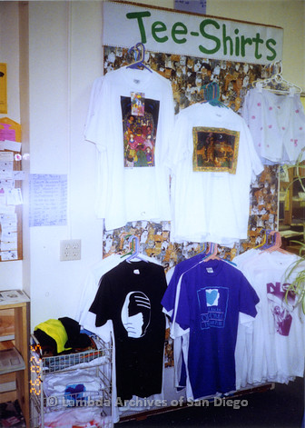"""P167.022m.r.t Paradigm Women's Bookstore: """"Tee-Shirts"""" display with sign"""