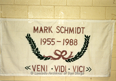 """P019.049m.r.t AIDS Quilt at San Diego Golden Hall 1988: White quilt with laurel leaves dedicated to Mark Schmidt, with inscription """"Veni. Vidi. Vici"""""""