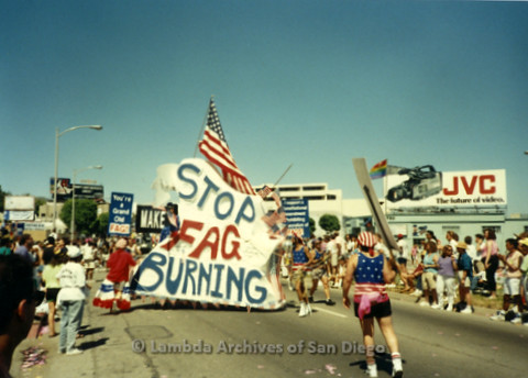 """P341.041m.r.t Group marching in LA Pride Parade holding a sign that reads """"Stop Fag Burning"""""""
