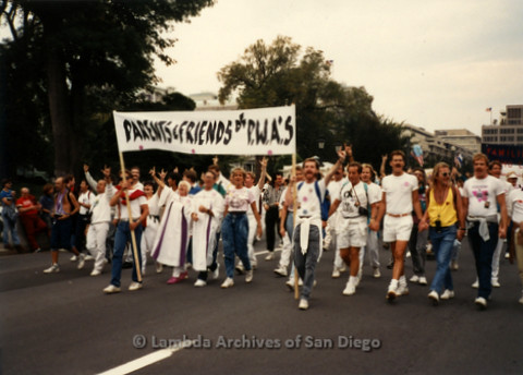 "P019.283m.r.t Second March on Washington 1987: People marching on street, banner reads: ""PARENTS & FRIENDS of P.W.A.'S"""