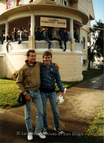 P019.179m.r.t March on Sacramento 1988 / Pre Parade gathering: Two men standing in front of Lambda Community Center