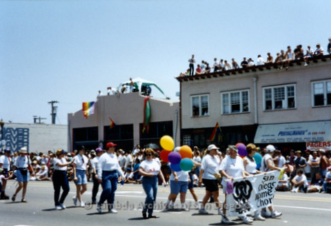 San Diego LGBTQ Pride Parade, July 1995: San Diego Women's Chorus walks the parade route carrying their banner