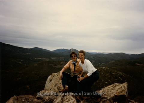P008.112m.r.t Cowles Mountain 1984: Sandy Johnson and another hiker posing on a rock