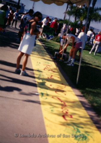 P197.016m.r.t AIDS Walk San Diego 1991: Yellow banner on the ground under canopy