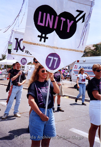 P018.123m.r.t San Diego Pride Parade 1994: Connie holding Lesbian and Gay Archives banner