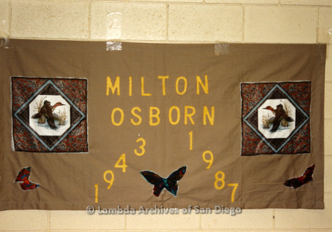 P019.034m.r.t AIDS Quilt at San Diego Golden Hall 1988: Butterfly and duck decorated brown quilt dedicated to Milton Osborn