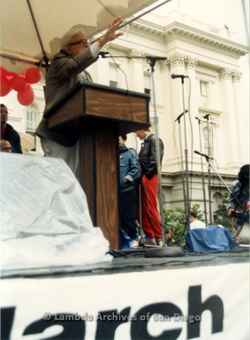 P019.109m.r.t March on Sacramento 1988 / Pre Parade gathering: Close up of Morris Kight speaking in front of City Hall