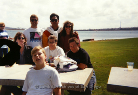P197.035m.r.t AIDS Walk San Diego 1993: Group of volunteers around table at Crown Point picnic