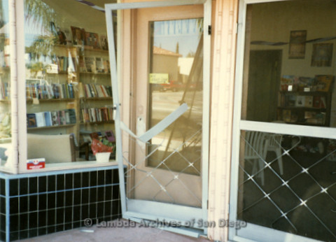 P169.089m.r.t Paradigm Women's Bookstore Grand Opening: Exterior of bookstore with broken screen door