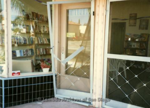 P169.089m.r.t Paradigm Women's Bookstore Grand Opening: Exterior of bookstore with broken screen door