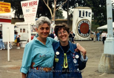 San Diego LGBT Pride Festival, July 1999: LGBT Pride Board Member Judi Schaim (left) and Partner Karen Marshall (right) Former San Diego LGBT Community Center CEO, at the Pride Festival in the Old Navy Hospital Parking Lot.