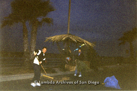 P263.012m.r.t Front Runners and Walkers of San Diego: Two men cleaning up after the marathon at night