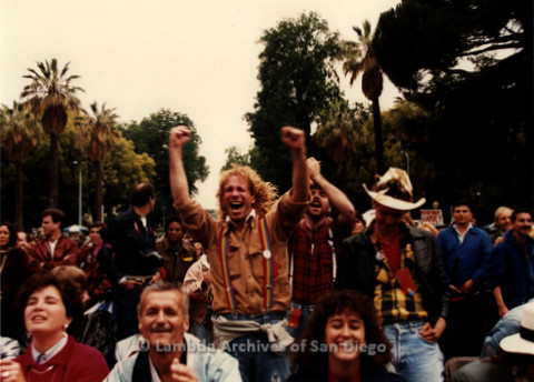 P019.387m.r.t March on Sacramento1988: Man cheering in center of protestors