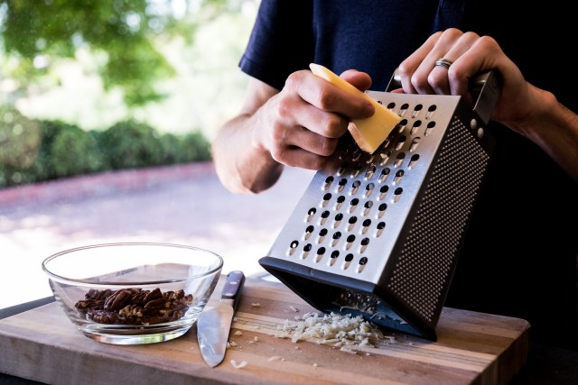 grating parmesan while the pecans cool off