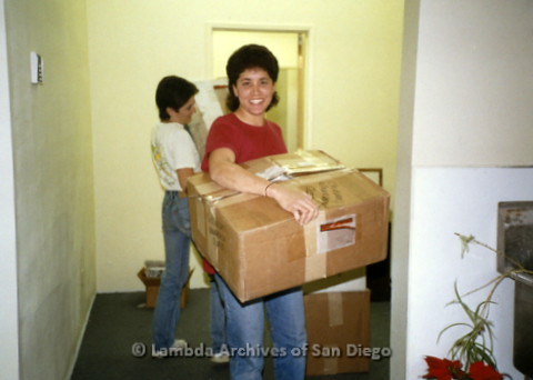 P169.035m.r.t Paradigm Women's Bookstore - Moving in: Two women carrying boxes in to store