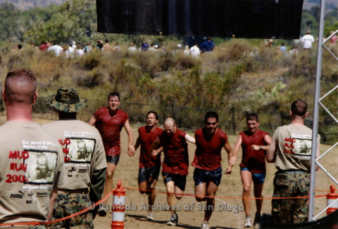 P259.003m.r.t Camp Pendleton Mud Run: Runners holding hands while running