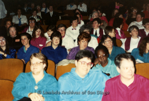 """""""The Magic Music Makes"""" San Diego Women's Chorus (SDWC) first choral festival with Sister Singers 1991: Chorus members watching other chorus groups Perform, Carol Reagan (front middle)"""