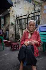Old Woman Smoking a Cigarette