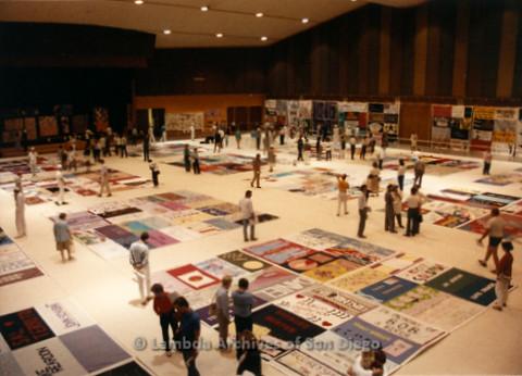 P019.183m.r.t AIDS Quilt at San Diego Golden Hall 1988: People walking around the AIDS Quilt exhibit