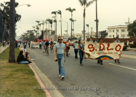 1982 - San Diego Lambda Pride Parade, 'San Diego Lesbian Organization' (S.D.L.O.) Contingent marching with their banner up 6th avenue from the west end of Balboa Park toward Hillcrest.