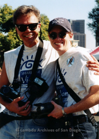 P119.071m.r.t San Diego Pride 1997: Jana Heder and a man carrying professional cameras