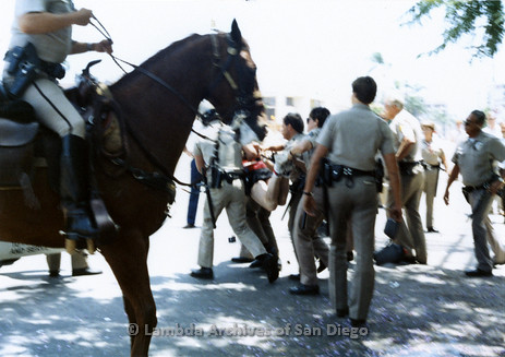 San Diego Lambda Pride Parade: Police officers restraining and Carrying away a Gay Man from the San Francisco Lesbian/Gay Freedom Band, provoked by the hundreds of Christian Fundamentalist protesters on Fifth Avenue in Hillcrest. Missin