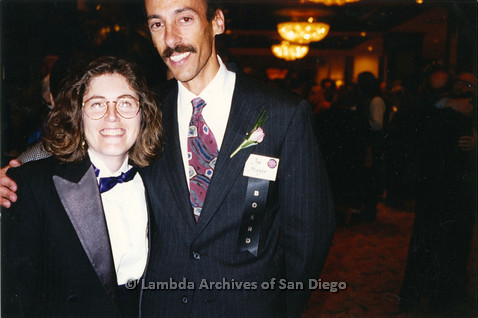 "P237.027m.r.t Center Events: Joe Mayer (right) wearing a ""BOARD"" ribbon, standing with Karen Marshall"
