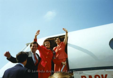 P341.029m.r.t Barbara Boxer and Dianne Feinstein waving while disembarking plane