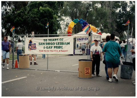 "P201.033m.r.t San Diego Pride Festival 1994: ""20 Years of San Diego Lesbian and Gay Pride-Thank You for your Pride and Support"" sign hanging on festival entry gate"